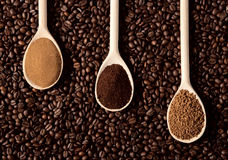 Three types of coffee. On coffee beans Royalty Free Stock Photo