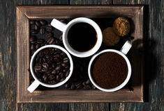 Three types of coffee - ground, grain, beverage and cookies Royalty Free Stock Photo