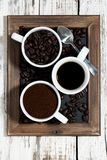 Three types of coffee - ground, grain and beverage Royalty Free Stock Photography