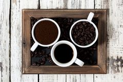 Three types of coffee - ground, grain and beverage Stock Photo
