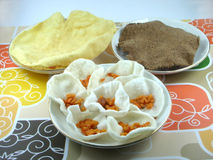 Three types of Indian wafers known as pappads. Three types of Indian wafers known as papads, which are used as side dishes for lunch and dinner.  The smaller Royalty Free Stock Photo