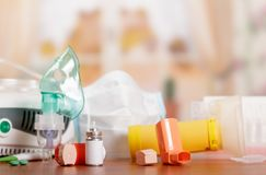 Three types of inhalers - mesh nebulizer, a compressor and a small portable on table. Three types of inhalers - mesh nebulizer, a compressor and a small portable Stock Photos