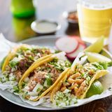 Three types of mexican street tacos with barbacoa, carnitas and Chicharrón stock image
