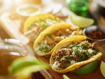 Three types of mexican street tacos with barbacoa, carnitas and Chicharrón royalty free stock image