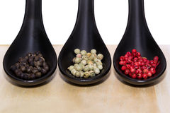 Three types of peppercorns Stock Photography