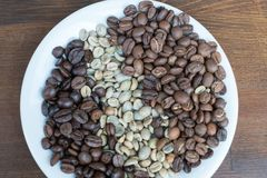 Three Types Of Coffee Beans On Plate Stock Images