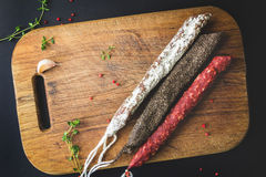 Three types of spanish sausages on wooden board Stock Photo