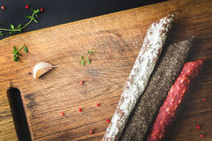 Three types of spanish sausages on wooden board Royalty Free Stock Images