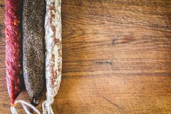 Three types of spanish sausages on wooden board Stock Photography