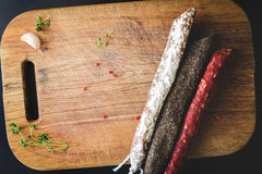 Three types of spanish sausages on wooden board Stock Image