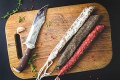 Three types of spanish sausages on wooden board Royalty Free Stock Photography
