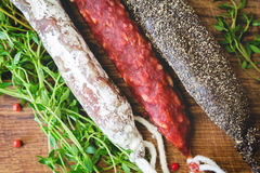 Three types of spanish sausages on wooden board Royalty Free Stock Photos