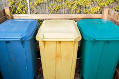 Three types of waste separation tanks on the beach in Italy. Hazardous waste, Dry garbage, wet waste. Environmental care. Organize trash bins to separate for Stock Photo