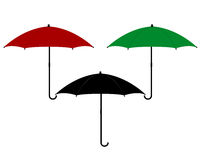 Three umbrellas in different colors Royalty Free Stock Images