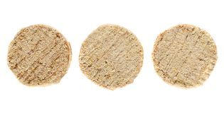 Three uncooked meat cutlets isolated on white background. Top view Stock Photography