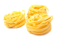 Three uncooked pasta nests. With soft shadow on white background stock images