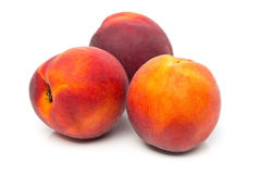 Three uncut, whole, ripe peaches fruit royalty free stock photo