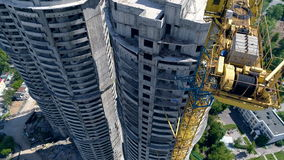 Three unfinished building towers in residential area. A set of three apartment buildings finished by half stock video