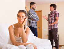 Three unhappy adults having argue Stock Images