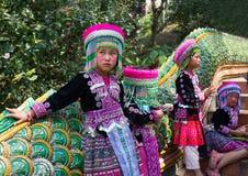Three unidentified Akha children pose for tourist photos at Wat Phratat Doi Suthep on in Chiang Mai, Thailand. royalty free stock photos