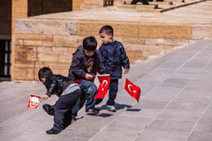 Three unidentified boys at the Anıtkabir in Ankara, Turkey. ANKARA, TURKEY – APRIL 16: Three unidentified boys prepare to honor Mustafa Kemal Atatürk, the Stock Photos