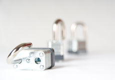 Three unlocked padlocks. Focus on the one in front Royalty Free Stock Photo