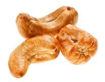 Three unshelled roasted cashew nuts Stock Image