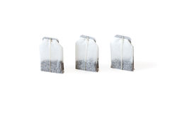 Three unused teabags isolated on white background stock photography