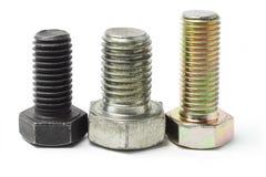 Three used bolts Royalty Free Stock Photos