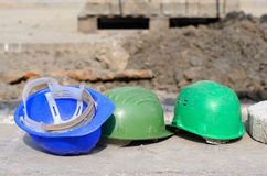 Three used helmet in construction Royalty Free Stock Images