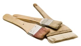 Used Paint Brushes. Three used paintbrushes  on white background Stock Images
