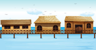Three vacation houses on water Royalty Free Stock Photos