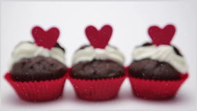 Three valentines cupcakes on white background close up. Focus shot stock video