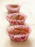 Three valentines muffins in a row. Homemade pastry. Selective focus on the front. Vertical Royalty Free Stock Photography