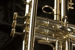Three valves and finger buttons closeup of glden trumpet stock image