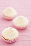 Three vanilla cupcakes Stock Photo