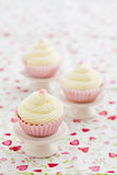 Three vanilla cupcakes Royalty Free Stock Images