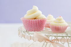 Three vanilla cupcakes Stock Photos