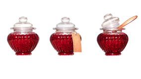 Banks with raspberry jam on a white background. Isolated. Three variants of packing a raspberry jam in a glass jar Royalty Free Stock Images