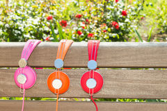 Three varicolored headphones of different colors Stock Image