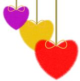 Three varicoloured fluffy hearts on a white background Stock Image