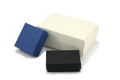 Three Varied Gift Boxes. Three gift boxes of various sizes in black, blue and cream coloured cardboard, isolated on white background stock photos