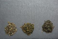 Three varieties of green tea on adark background. Different grades of green tea royalty free stock photography