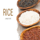 Three varieties of rice in wooden bowls, selective focus Royalty Free Stock Image