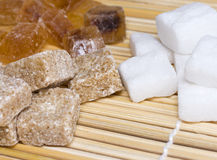 Three varieties of sugar in a straw napkin Stock Photos