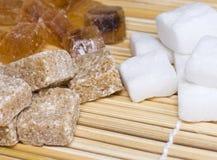 Three varieties of sugar in a straw napkin. Three varieties of sugar lying on straw napkin Stock Photos