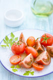 Three varieties of tomato on a plate Stock Photo