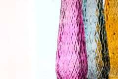 Three vases of colored glass with a pattern stock photography