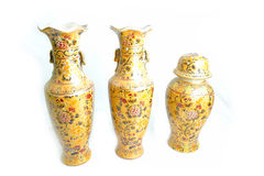 Three Vases decorated in gold Royalty Free Stock Images