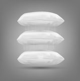 Three vector cushion falling on a gray background Stock Photography